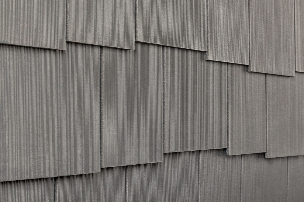 10099090-cerber-rustic-fcshingle-panel-combed-staggered-weathered-gray-angle