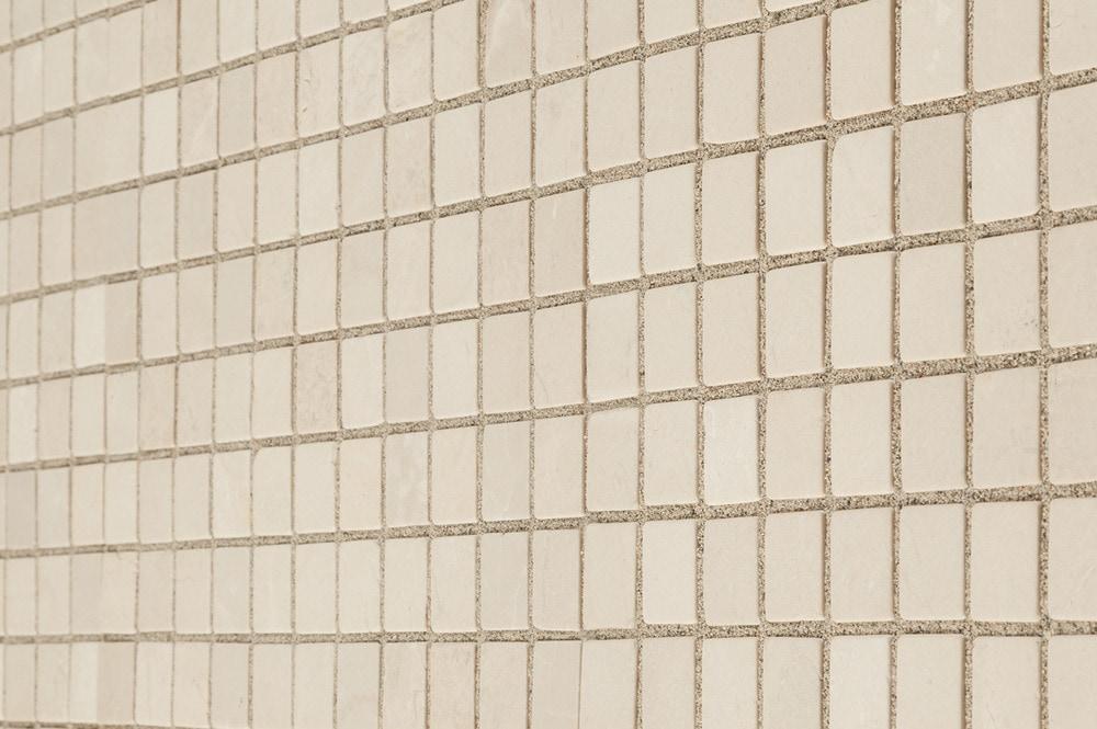 crema-marfil-tumbled-1x1-angle