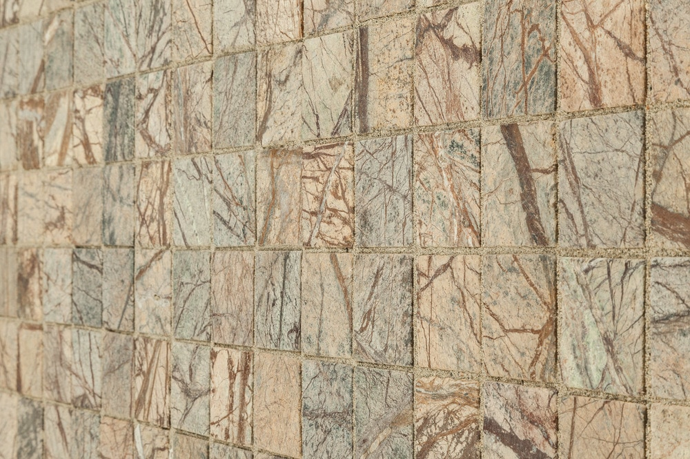 marble-cafe-forest-motif-tumbled-2x2-angle