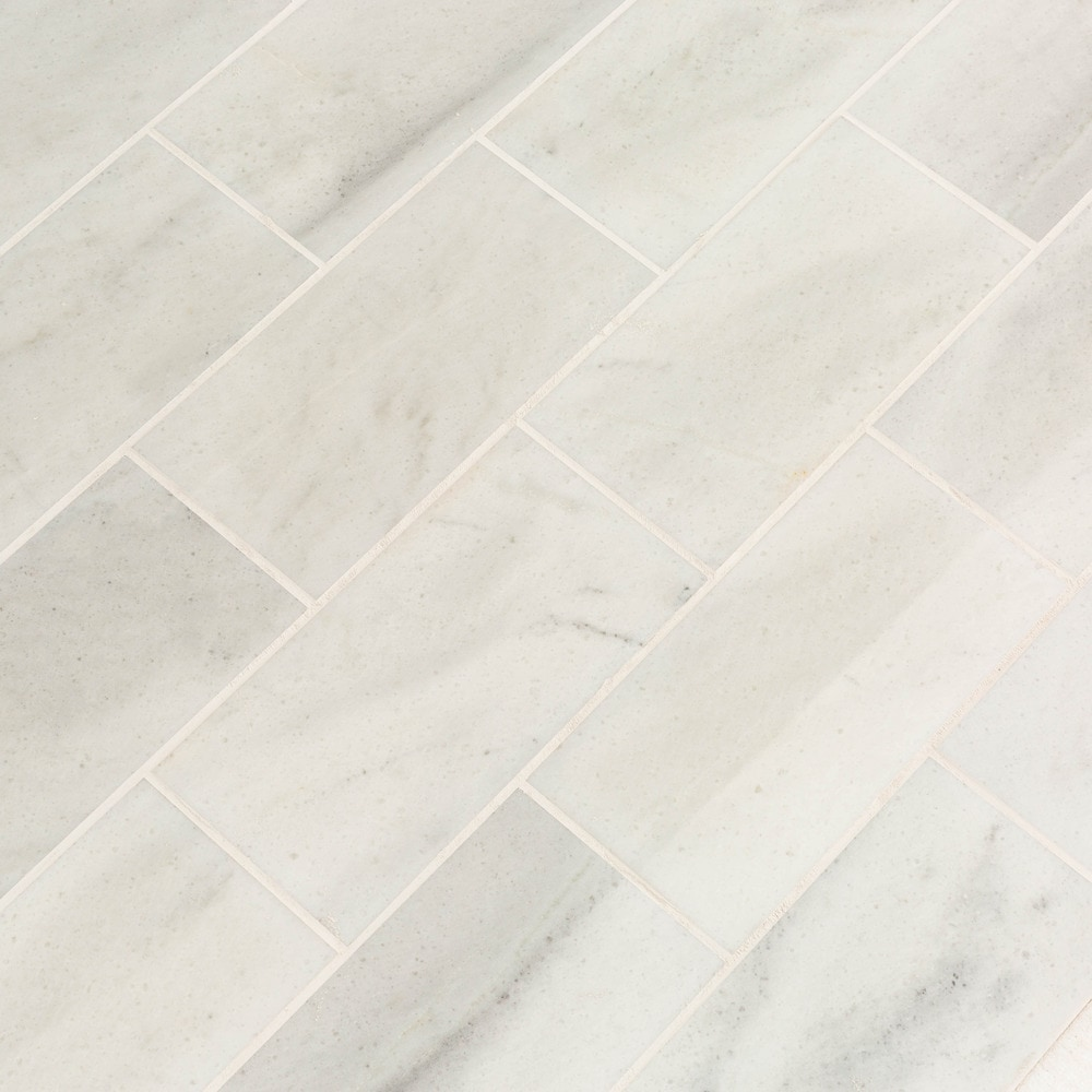 ibiza_white_marble_tiles_18x36_multi_closeup_angle_5afff266497ea